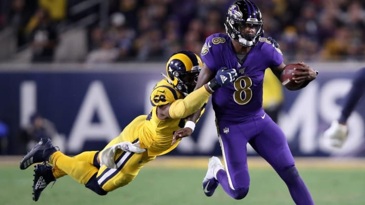 LOS ANGELES, CALIFORNIA - NOVEMBER 25:  Dante Fowler Jr. #56 of the Los Angeles Rams chases Lamar Jackson #8 of the Baltimore Ravens during the second half of a game at Los Angeles Memorial Coliseum on November 25, 2019 in Los Angeles, California. (Photo by Sean M. Haffey/Getty Images)