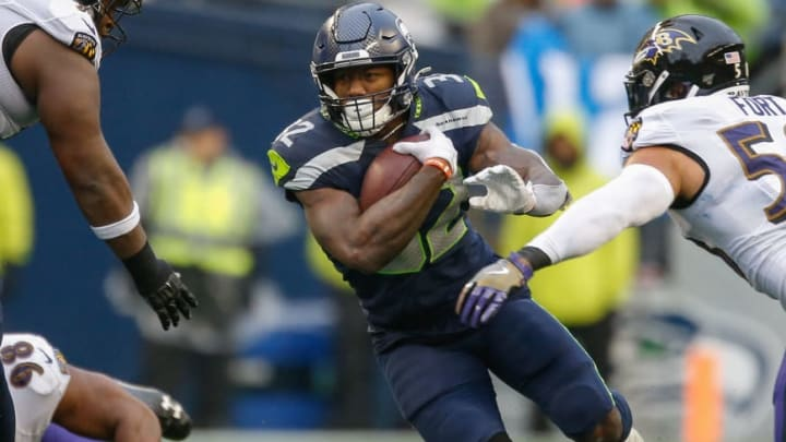 SEATTLE, WA - OCTOBER 20:  Running back Chris Carson #32 of the Seattle Seahawks rushes against the Baltimore Ravens at CenturyLink Field on October 20, 2019 in Seattle, Washington.  (Photo by Otto Greule Jr/Getty Images)