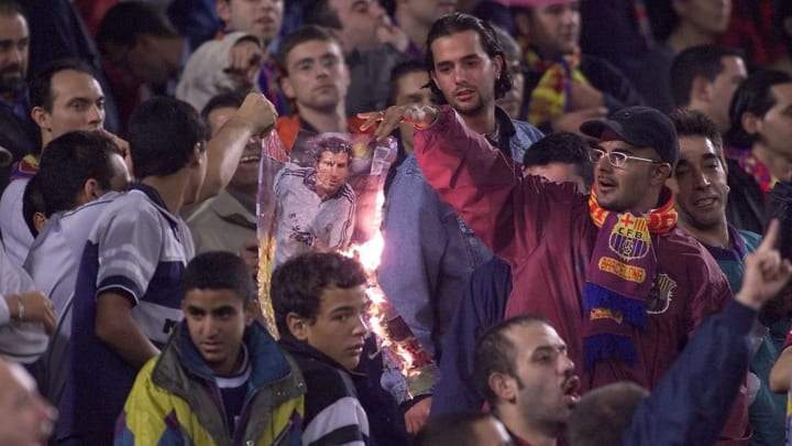 Barcelona supporters burn a portrait of Portugese