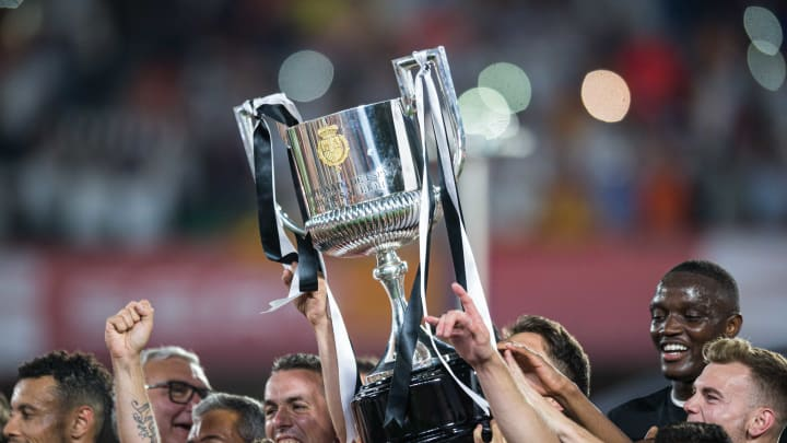 Players of FC Valencia celebrate with the trophy