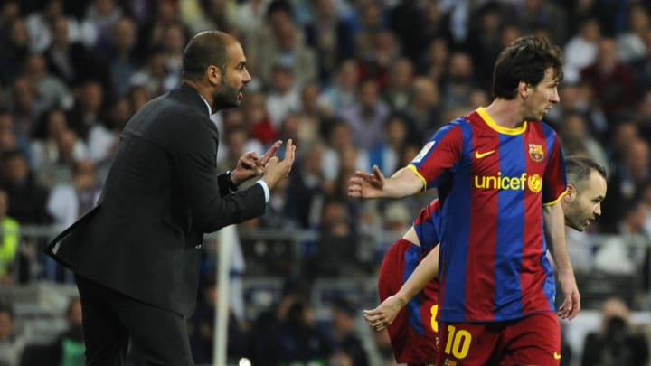 Barcelona's coach Josep Guardiola (L) sp