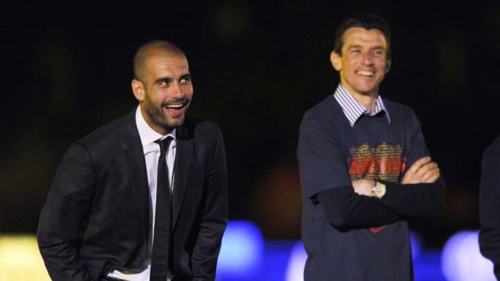 Barcelona's coach Pep Guardiola (L) cele