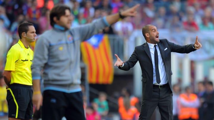 Barcelona's coach Pep Guardiola (R) and