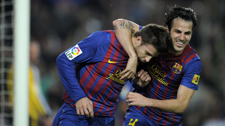 Barcelona's defender Gerard Pique (L) an