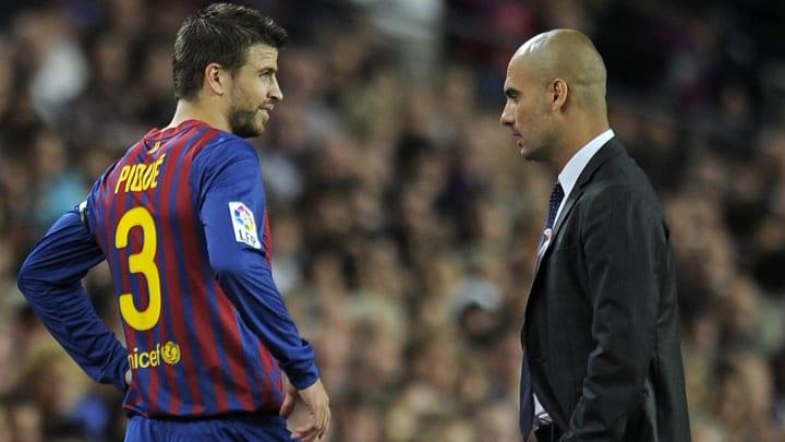 Barcelona's defender Gerard Pique (L) ta