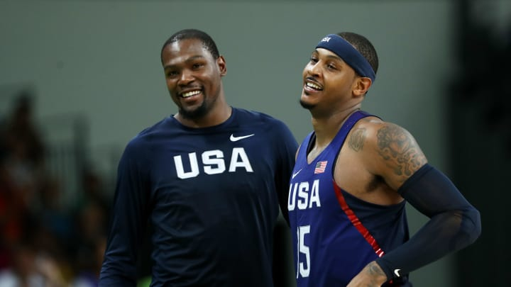 RIO DE JANEIRO, BRAZIL - AUGUST 21:  Kevin Durant and Carmelo Anthony #15 of United States celebrates after defeating Serbia during the Men's Gold medal game on Day 16 of the Rio 2016 Olympic Games at Carioca Arena 1 on August 21, 2016 in Rio de Janeiro, Brazil.  (Photo by Elsa/Getty Images)