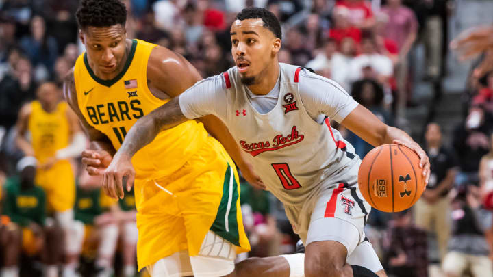 Texas Tech's Kyler Edwards dribbles past a defender against Baylor.