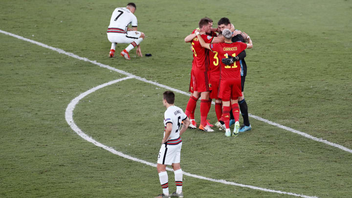 Belgium's players celebrate with Cristiano Ronaldo distraught in the background
