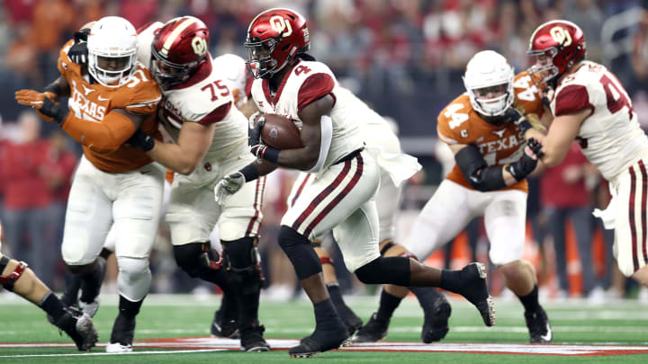 ARLINGTON, TEXAS - DECEMBER 01:  Trey Sermon #4 of the Oklahoma Sooners runs the ball against the Texas Longhorns in the first quarter at AT&T Stadium on December 01, 2018 in Arlington, Texas. (Photo by Ronald Martinez/Getty Images)