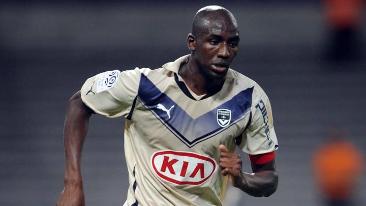 Bordeaux's captain Alou Diarra runs with