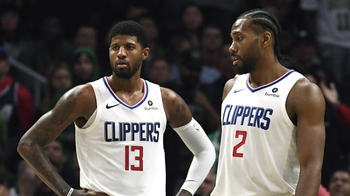 LOS ANGELES, CA - NOVEMBER 20: Paul George #13 Los Angeles Clippers and Kawhi Leonard #2 during overtime against Boston Celtics at Staples Center on November 20, 2019 in Los Angeles, California. It was the first time this season the pair played together after joining the Clippers. NOTE TO USER: User expressly acknowledges and agrees that, by downloading and/or using this Photograph, user is consenting to the terms and conditions of the Getty Images License Agreement. (Photo by Kevork Djansezian/Getty Images)