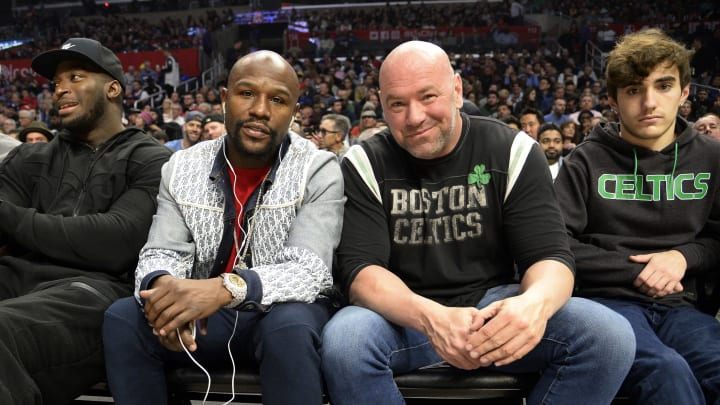Floyd Mayweather and Dana White a a Celtics game.