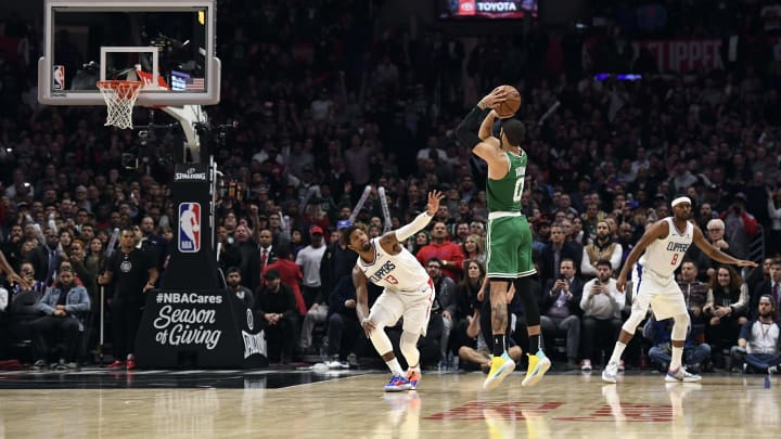 LOS ANGELES, CA - NOVEMBER 20: Jayson Tatum #0 of the Boston Celtics ties the game with a three-point basket in regulation to force overtime against Paul George #13 of the Los Angeles Clippers at Staples Center on November 20, 2019 in Los Angeles, California. NOTE TO USER: User expressly acknowledges and agrees that, by downloading and/or using this Photograph, user is consenting to the terms and conditions of the Getty Images License Agreement. (Photo by Kevork Djansezian/Getty Images)