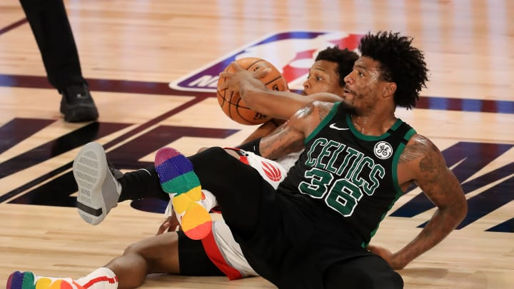 Marcus Smart and Kyle Lowry get tangled up