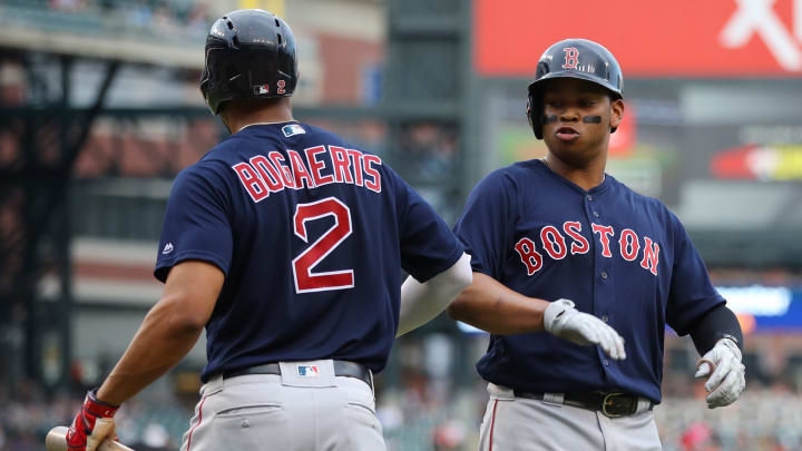 DETROIT, MICHIGAN - JULY 05: Rafael Devers #11 of the Boston Red Sox celebrates scoring a run in the third inning with Xander Bogaerts #2 while playing the Detroit Tigers at Comerica Park on July 05, 2019 in Detroit, Michigan. (Photo by Gregory Shamus/Getty Images)
