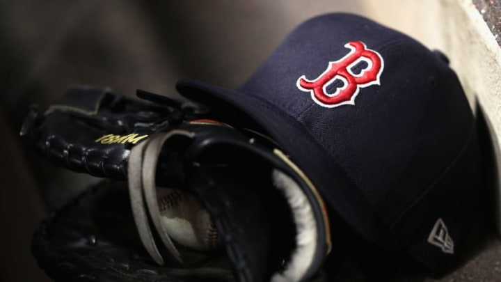 ANAHEIM, CA - APRIL 18:  A detail of a Boston Red Sox hat and glove during  a game against the Los Angeles Angels of Anaheim  at Angel Stadium on April 18, 2018 in Anaheim, California.  (Photo by Sean M. Haffey/Getty Images)