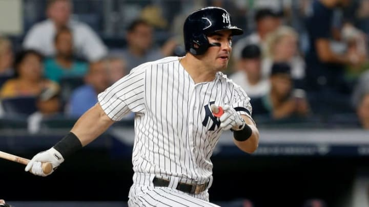 NEW YORK, NEW YORK - AUGUST 04:   Mike Tauchman #39 of the New York Yankees follows through on a third inning two run single against the Boston Red Sox at Yankee Stadium on August 04, 2019 in New York City. (Photo by Jim McIsaac/Getty Images)