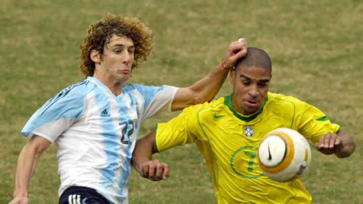 Brazilian Adriano (R) tries to evade Arg