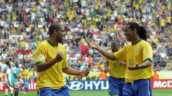 Brazilian forward Adriano (L) celebratin