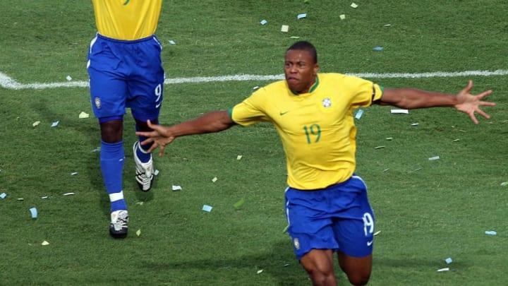 Brazil's footballer Julio Baptista (R) c...