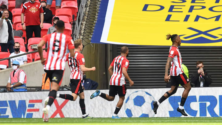 Brentford celebrate the opening goal of the game