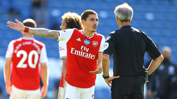Hector Bellerin protests with referee Martin Atkinson