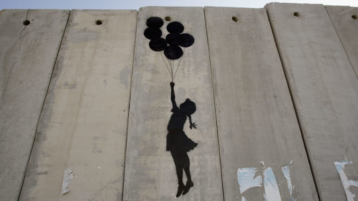 British Guerrilla Artist Decorates West Bank Barrier