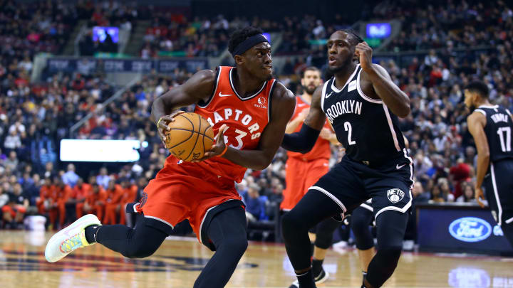 Raptors star Pascal Siakam driving against the Nets