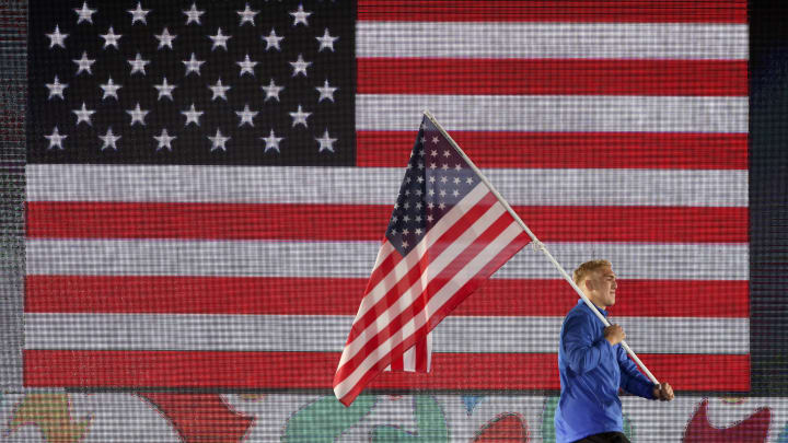 Who are the US flag bearers for Olympics 2021? Team USA flag bearers for 2021 Tokyo Olympics include Eddy Alvarez and Sue Bird.