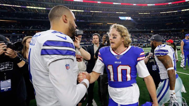 ARLINGTON, TEXAS - NOVEMBER 28: Dak Prescott #4 of the Dallas Cowboys meets Cole Beasley #10 of the Buffalo Bills on the field after the game at AT&T Stadium on November 28, 2019 in Arlington, Texas. (Photo by Richard Rodriguez/Getty Images)