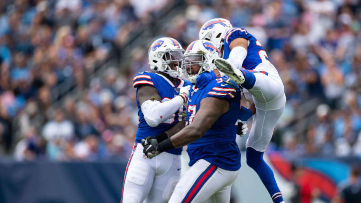 NASHVILLE, TN - OCTOBER 06:  (L-R) Shaq Lawson #90, Jordan Phillips #97 and Kevin Johnson #29 of the Buffalo Bills celebrate a sack by Phillips during the first quarter against the Tennessee Titans at Nissan Stadium on October 6, 2019 in Nashville, Tennessee. Buffalo defeats Tennessee 14-7.  (Photo by Brett Carlsen/Getty Images)
