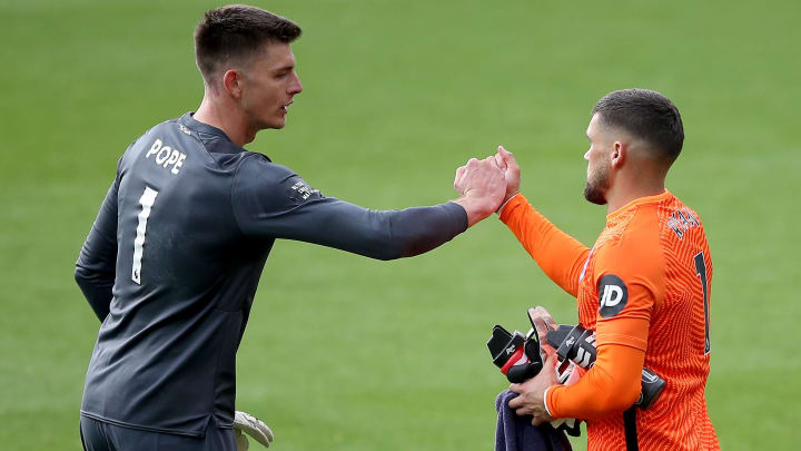 Burnley's Nick Pope embraces Brighton goalkeeper Mat Ryan