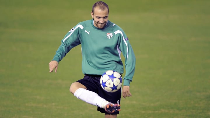 Bursaspor's Sercan Yildirim plays with a