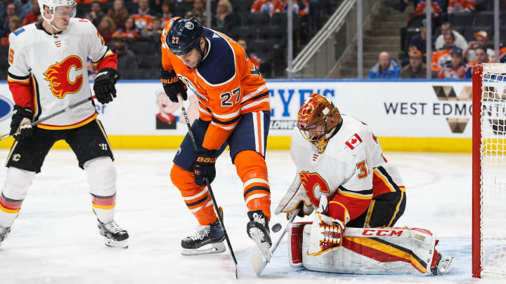 EDMONTON, AB - JANUARY 25: Milan Lucic #27 of the Edmonton Oilers can't get a shot past goaltender David Rittich #33 of the Calgary Flames at Rogers Place on January 25, 2018 in Edmonton, Canada. (Photo by Codie McLachlan/Getty Images)