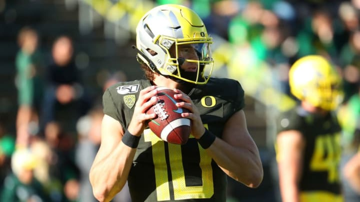 EUGENE, OREGON - OCTOBER 05: Justin Herbert #10 of the Oregon Ducks warms up prior to taking on the California Golden Bears during their game at Autzen Stadium on October 05, 2019 in Eugene, Oregon. (Photo by Abbie Parr/Getty Images)