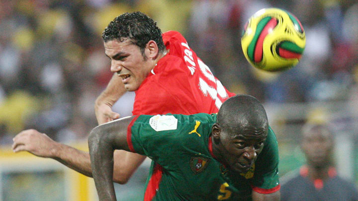 Cameroon's Timothee Atouba (R) fights fo