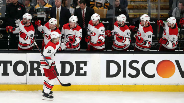 BOSTON, MASSACHUSETTS - MAY 09: Sebastian Aho #20 of the Carolina Hurricanes celebrates with teammates after scoring a goal during the first period against the Boston Bruins in Game One of the Eastern Conference Final during the 2019 NHL Stanley Cup Playoffs at TD Garden on May 09, 2019 in Boston, Massachusetts. (Photo by Adam Glanzman/Getty Images)
