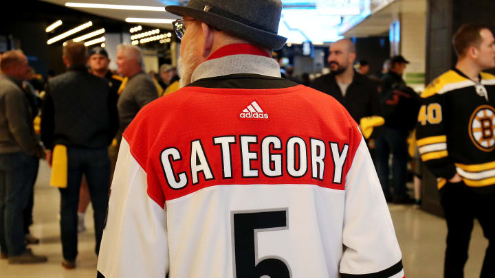 BOSTON, MASSACHUSETTS - MAY 12: A Carolina Hurricanes fan walks through the concourse prior to Game Two of the Eastern Conference Final between the Carolina Hurricanes and the Boston Bruins during the 2019 NHL Stanley Cup Playoffs at TD Garden on May 12, 2019 in Boston, Massachusetts. (Photo by Adam Glanzman/Getty Images)