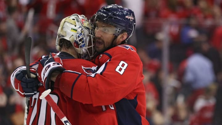 WASHINGTON, DC - APRIL 20: Goalie Braden Holtby #70 of the Washington Capitals celebrates with teammates Alex Ovechkin #8  after defeating the Carolina Hurricanes in Game Five of the Eastern Conference First Round during the 2019 NHL Stanley Cup Playoffs at Capital One Arena on April 20, 2019 in Washington, DC. (Photo by Patrick Smith/Getty Images)