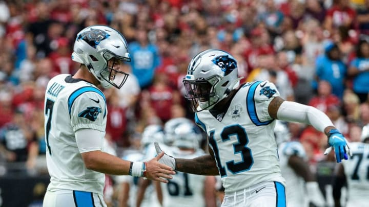 GLENDALE, ARIZONA - SEPTEMBER 22: Quarterback Kyle Allen #7 and wide receiver Jarius Wright #13 of the Carolina Panthers celebrate a touchdown in the second half of the NFL game against the Arizona Cardinals at State Farm Stadium on September 22, 2019 in Glendale, Arizona. The Carolina Panthers won 38-20. (Photo by Jennifer Stewart/Getty Images)