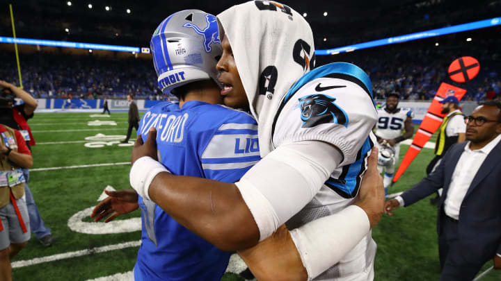 DETROIT, MI - OCTOBER 08: Quarterback Cam Newton #1 of the Carolina Panthers gives quarterback Matthew Stafford #9 of the Detroit Lions a hug after the Carolina Panthers defeated the Detroit Lions 27-24 at Ford Field on October 8, 2017 in Detroit, Michigan. (Photo by Gregory Shamus/Getty Images)