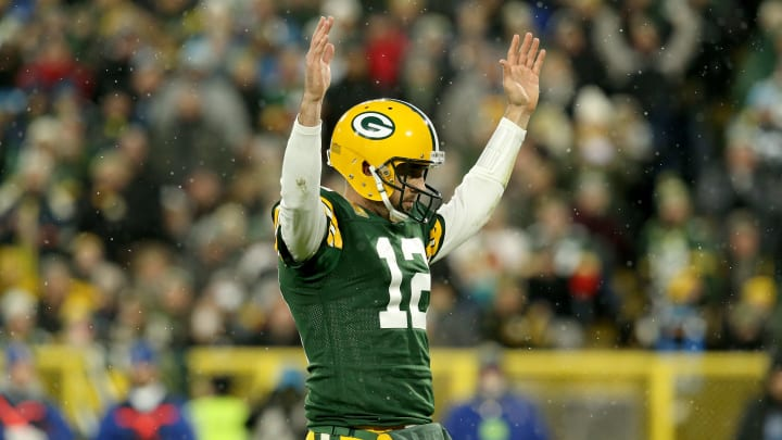 GREEN BAY, WISCONSIN - NOVEMBER 10: Aaron Rodgers #12 of the Green Bay Packers celebrates a touchdown scored by Aaron Jones #33 against the Carolina Panthers during the second quarter in the game at Lambeau Field on November 10, 2019 in Green Bay, Wisconsin. (Photo by Dylan Buell/Getty Images)