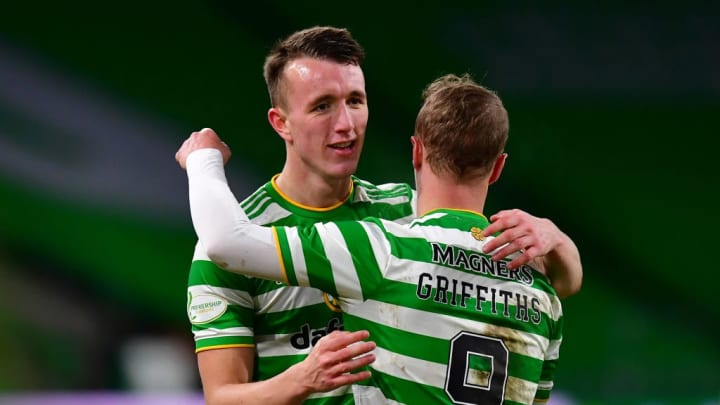Turnbull gets a nice hug from his Celtic team-mate