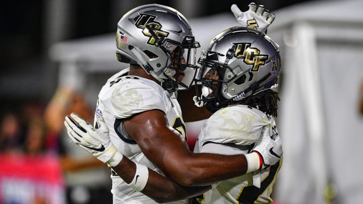 BOCA RATON, FLORIDA - SEPTEMBER 07: Bentavious Thompson #24 of the UCF Knights scores a touchdown in the second half against the Florida Atlantic Owls at FAU Stadium on September 07, 2019 in Boca Raton, Florida. (Photo by Mark Brown/Getty Images)