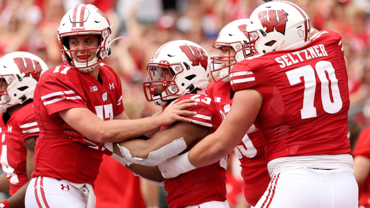 MADISON, WISCONSIN - SEPTEMBER 07:  Jonathan Taylor #23 of the Wisconsin Badgers celebrates with Jack Coan #17 and Josh Seltzner #70 after scoring a touchdown in the second quarter against the Central Michigan Chippewas at Camp Randall Stadium on September 07, 2019 in Madison, Wisconsin. (Photo by Dylan Buell/Getty Images)