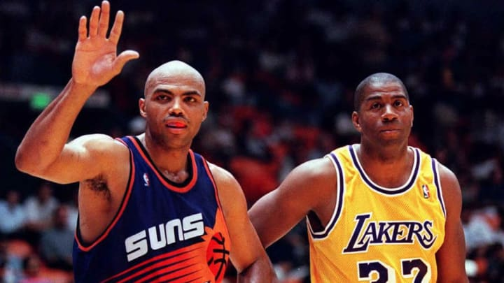 Charles Barkley of the Phoenix Suns waves to fans