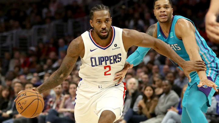 LOS ANGELES, CALIFORNIA - OCTOBER 28: Kawhi Leonard #2 of the Los Angeles Clippers dribbles past Miles Bridges #0 of the Charlotte Hornetsduring the first half of a game at Staples Center on October 28, 2019 in Los Angeles, California. NOTE TO USER: User expressly acknowledges and agrees that, by downloading and or using this photograph, User is consenting to the terms and conditions of the Getty Images License Agreement. (Photo by Sean M. Haffey/Getty Images)