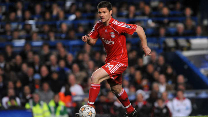 Xabi Alonso playing for Liverpool in the Champions League