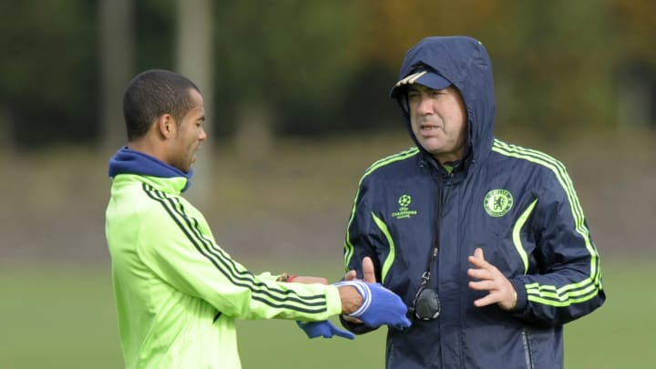 Chelsea's Ashley Cole (L) talks to manag