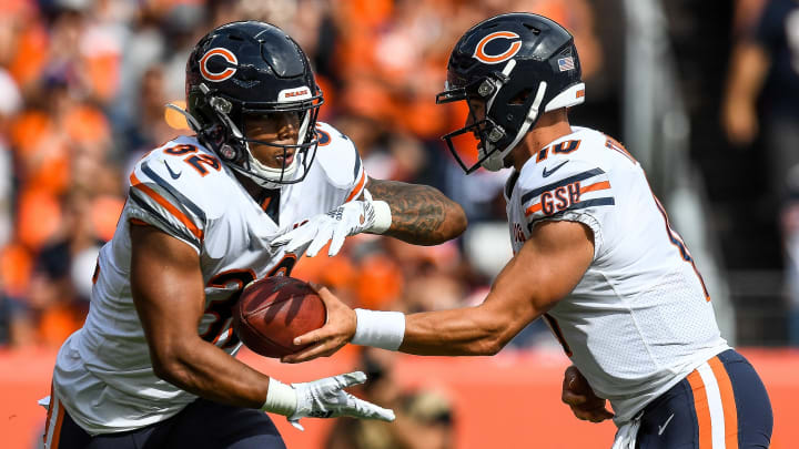 DENVER, CO - SEPTEMBER 15:  Mitchell Trubisky #10 of the Chicago Bears hands off to David Montgomery #32 in the second quarter of a game at Empower Field at Mile High on September 15, 2019 in Denver, Colorado. (Photo by Dustin Bradford/Getty Images)